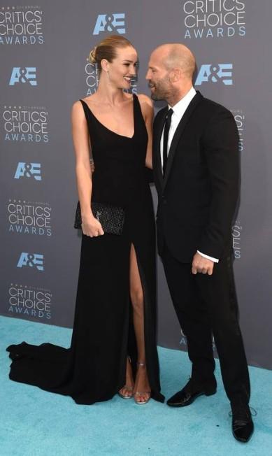 Rosie Huntington-Whiteley e Jason Statham: sintonia diante das câmeras Jason Merritt / AFP