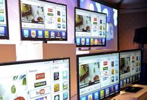 SmartTVs em exposição em uma feira em 2011 Foto: Jacob Kepler / Jacob Kepler/Bloomberg