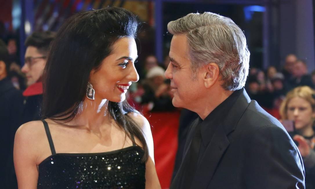 George Clooney e Amal: sintonia no red carpet FABRIZIO BENSCH / REUTERS