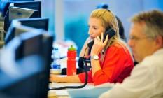 Mesmo trabalhando lado a lado, homens e mulheres recebem remunerações diferentes Foto: Aidan Crawley/Bloomberg