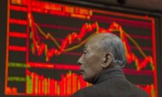 Painel exibe desempenho das Bolsas chinesas Foto: Ng Han Guan / AP