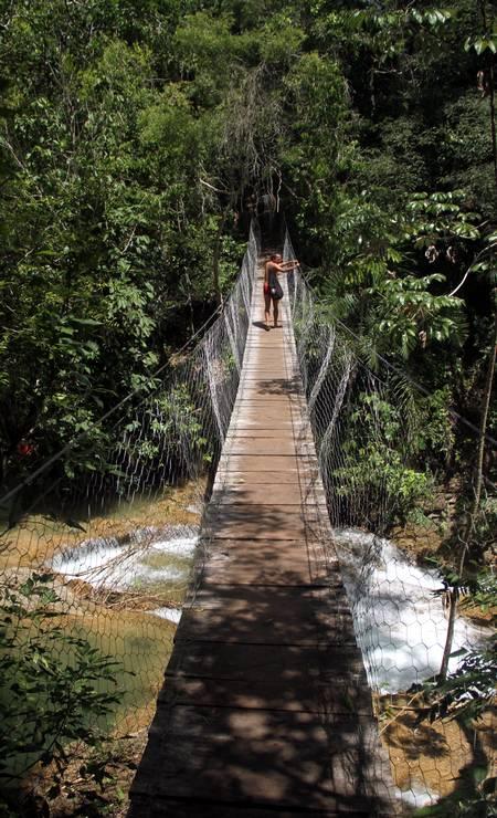 Na Fazenda Ceita Corê, visitantes passeiam por seis cachoeiras, em um circuito que tem até pontes suspensas Foto: Eduardo Vessoni / ,