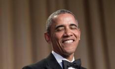 Barack Obama rindo da própria piada em jantar na Casa Branca Foto: NICHOLAS KAMM / AFP