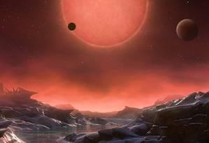 Ilustração da estrela Trappist 1 a partir da perspectiva de um dos planetas descobertos Foto: Divulgação/ESO