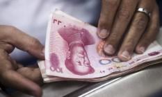 Salto. Dívida total chinesa saltou de 142% do PIB no fim de 2008 para 230% no fim de 2015 Foto: Xaume Olleros / Bloomberg