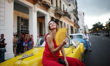 Havana virou a capital da moda na tarde de segunda-feira, quando a Chanel apresentou sua coleção resort na capital cubana. Gisele Bündchen, garota-propaganda do perfume Chanel Nº5, foi uma das estrelas que circularam pela cidade Foto: ALEXANDRE MENEGHINI/REUTERS