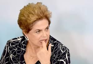 A presidente Dilma Rousseff participa de cerimônia no Palácio do Planalto antes da votação do impeachment no plenário do Senado Foto: Evaristo Sa / AFP / 6-5-2016