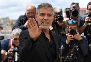 George Clooney em Cannes para o lançamento do filme 'Jogo do dinheiro' Foto: ANNE-CHRISTINE POUJOULAT / AFP