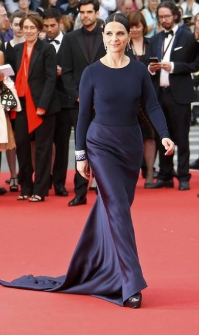 """Vencedora do Oscar de melhor atriz coadjuvante por sua atuação no filme """" O paciente inglês"""", de 1997, Juliette Binoche segue colecionando prêmios em sua carreira. Nos anos 1990, ela foi apontada como estrala mais bem paga do cinema francês. A atriz também já foi musa da marca de cosméticos Lancôme e posou para a Playboy YVES HERMAN/REUTERS"""