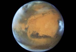 Imagem de Marte feita pelo telescópio espacial Hubble à medida que ele se aproxima de sua oposição Foto: Hubble/NASA/ESA/J. Bell/M. Wolff