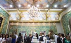 Sensorial. Inspirado no Palácio de Versalhes, estande da Favo105 tem papel de parede igual ao do museu e pintura com anjos no teto Foto: TatiFalavinha / Divulgação