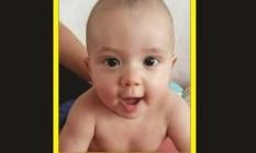 Cartaz com a foto do bebê Juan Rodrigues, morto após ser atingido por um tiro em São Gonçalo Foto: Reprodução