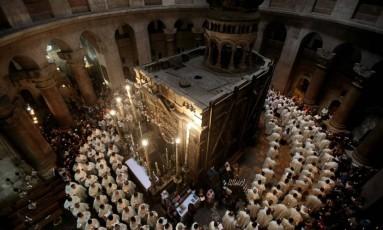 Missa na Igreja do Santo Sepulcro, em Jerusalém Foto: GALI TIBBON/AFP