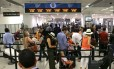 Fila em aeroporto Foto: AP