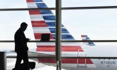 Aviões da American Airlines no aeroporto Ronald Reagan, em Washington Foto: Susan Walsh / AP/25-1-2016