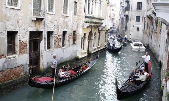 Gôndolas nos canais de Veneza, na Itália Foto: Giuseppe Aresu / Bloomberg News
