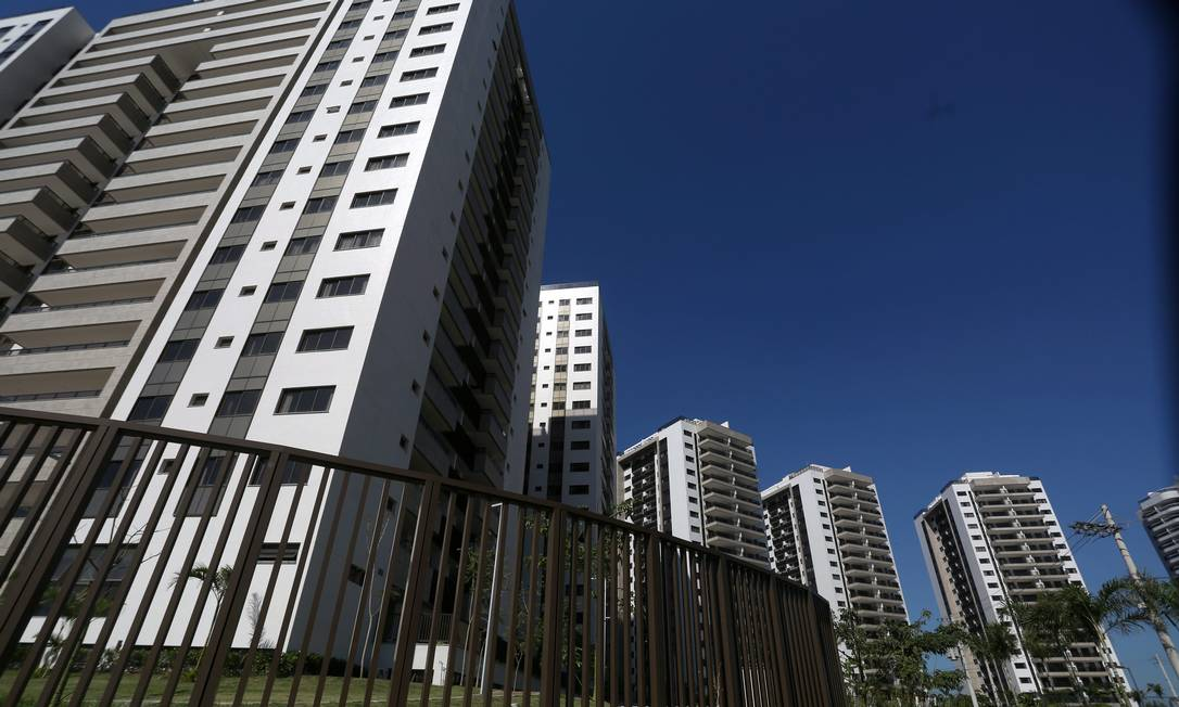 O empreendimento tem 31 edifícios, com um total de 3.604 apartamentos, todos adaptados para pessoas com deficiência ou pouca mobilidade Foto: Custódio Coimbra / Agência O Globo