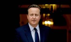 Primeiro-ministro britânico, David Cameron, caminha em frente ao Parlamento Foto: Matt Dunham / AP