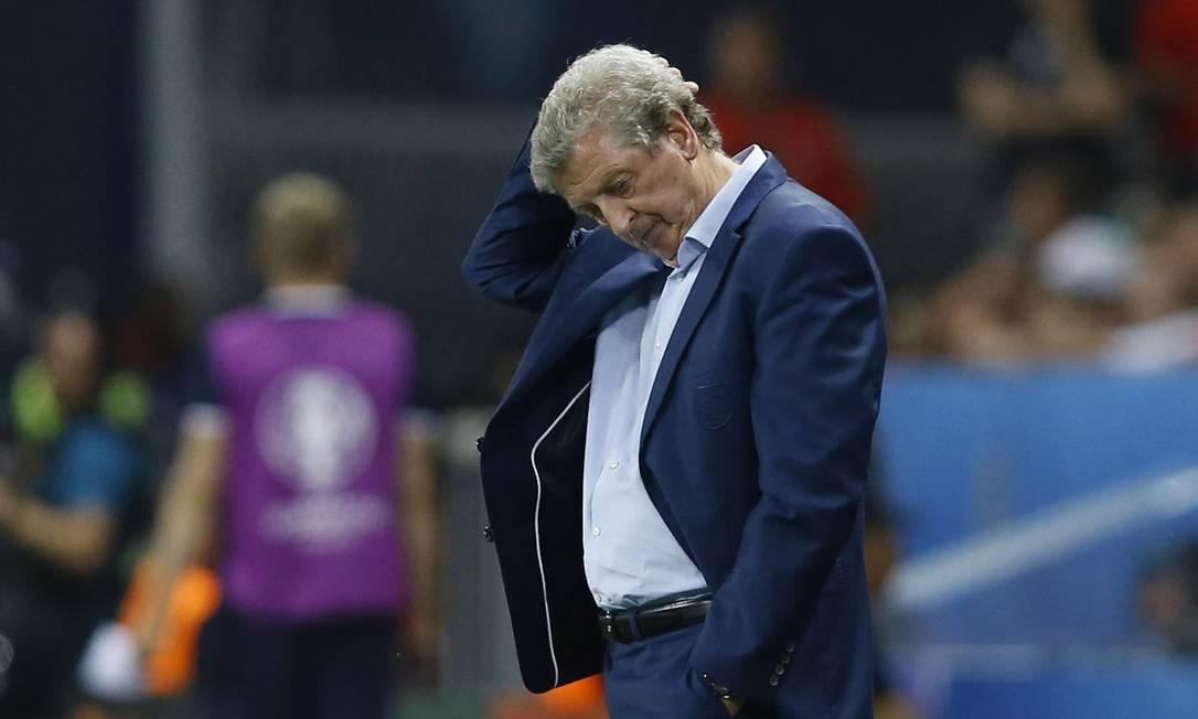 A desolação do técnico britânico, Roy Hodgson, durante a eliminação para a Islândia Kirsty Wigglesworth / AP