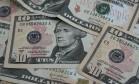 Na mínima desta terça-feira, dólar comercial atingiu patamar mais baixo em 11 meses Foto: STEPHEN HILGER / BLOOMBERG NEWS