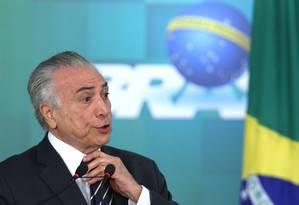 O presidente interino Michel Temer anuncia reajuste para o Bolsa Família em cerimônia no Palácio do Planalto Foto: Jorge William / Agência O Globo