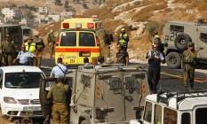 Polícia israelense investiga cena onde israelense morreu após suspeito palestino abrir fogo na Cisjordânia Foto: HAZEM BADER / AFP