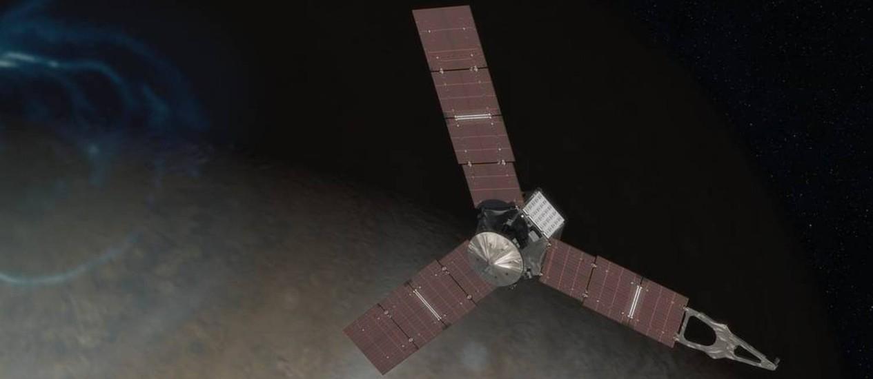 Ilustração da Nasa mostra a Juno sobre o Polo Norte de Júpiter: sonda vai enfrentar intensa radiação para desvendar os mistérios do planeta Foto: NASA/JPL-Caltech