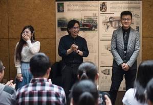 Professor conduz aula sobre relações amorosas na Universidade de Tianjin, na China Foto: FRED DUFOUR / AFP