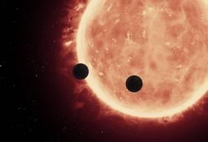 Ilustração mostra o trânsito dos dois planetas pela estrela anã que orbitam Foto: NASA