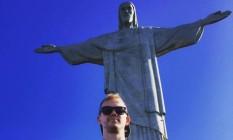 Lutador neozeolandês, que deixou o país esta semana, em visita ao Cristo Redentor Foto: Reprodução do Facebook