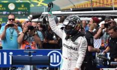 Nico Rosberg comemora melhor tempo no treino do GP da Alemanha Foto: PATRIK STOLLARZ / AFP