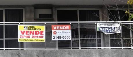 Anúncio de venda de imóvel na Lagoa: bairro é o terceiro mais caro do Rio Foto: MÁRCIO ALVES/AGÊNCIA O GLOBO