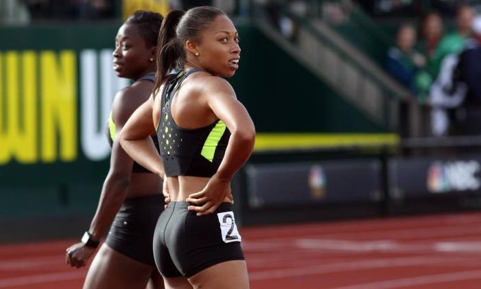 Allyson Felix (direita). Chance de medalha inédita nos 400 metros rasos Foto: Michael HEIMAN / AFP