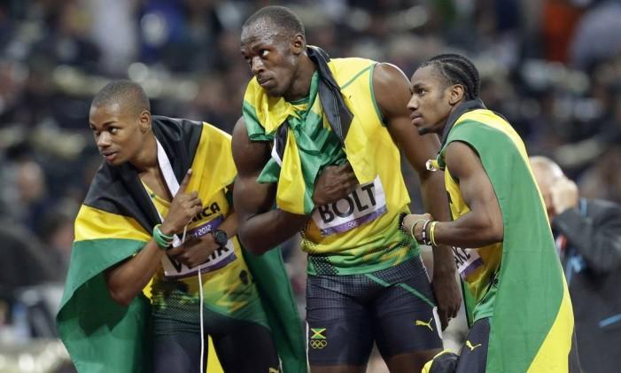 Jamaica de Warren weir, Usain bolt e Yohan Blake busca terceiro ouro consecutivo no revezamento 4 x 100 metros Foto: Lee Jin-man / AP