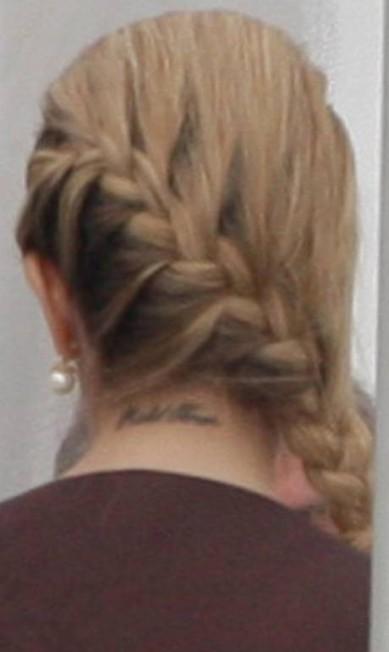 Na ocasião, fotógrafos também repararam na tatuagem na nuca com o nome do marido Dida Sampaio / Agência O Globo