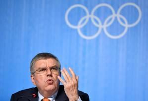 O presidente do Comitê Olímpico Internacional, Thomas Bach, em entrevista coletiva nesta quinta-feira, na véspera da cerimônia de abertura do Rio-2016 Foto: FABRICE COFFRINI / AFP