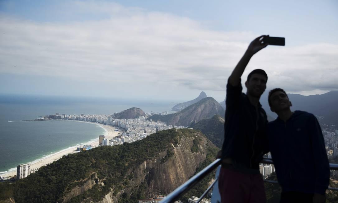 ... que os turistas não deixaram escapar. David Goldman / AP