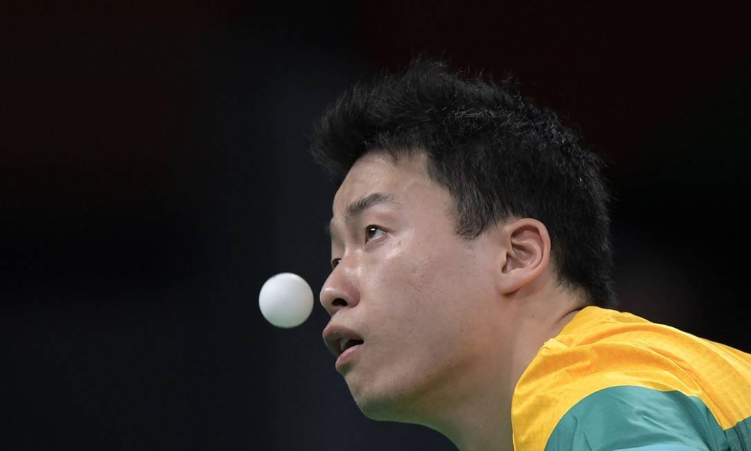 Chris Yan, da Austrália, durante preliminar simples masculino JUAN MABROMATA / AFP