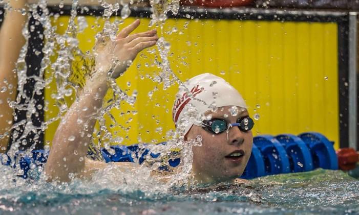 A nadadora americana bateu o recorde olímpico dos 100m peito, com 1m04s93. Superou a marca de 1m05s64, pertencente à australiana Leisel Jones Foto: COI / Divulgação