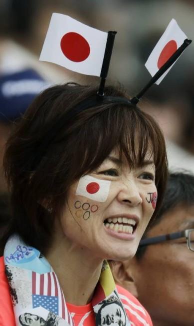 A japonesa mostra apoio ao país de todas as formas Eduardo Verdugo / AP
