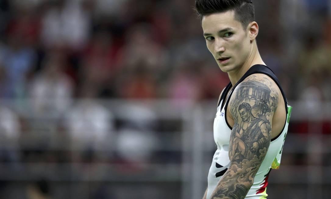 Além de músculos e curvas dignas do Olimpo, muitos atletas que competem na Rio-2016 ostentam também desenhos tatuados no corpo. É o caso do ginasta alemão Marcel Nguyen. Veja mais DAMIR SAGOLJ / REUTERS