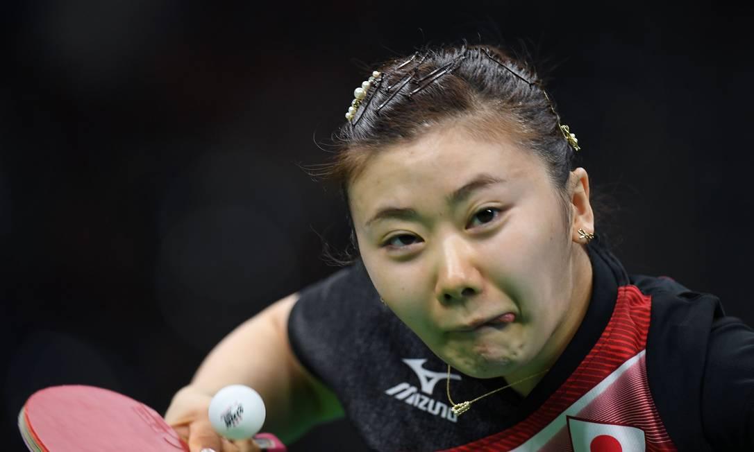 A japonesa Ai Fukuhara, do tênis de mesa, lança uma raquetada poderosa JIM WATSON / AFP