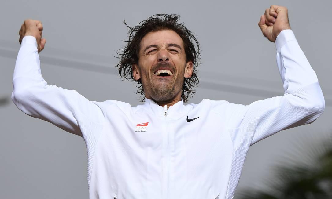 O suíço Fabian Cancellara assusta qualquer criança com essa comemoração pela medalha de ouro no contrarrelógio do ciclismo de estrada ERIC FEFERBERG / AFP