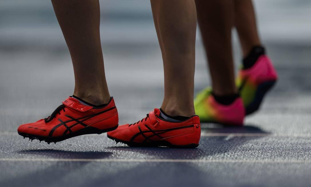 Bateria classificatoria dos 100m com barreira feminina no primeiro dia das provas de atletismo da Olimpiada Daniel Marenco / Agência O Globo