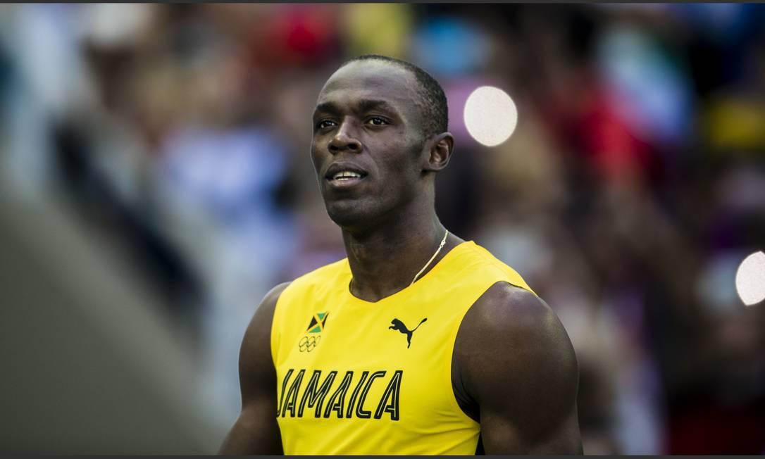 O atleta jamaicano atento ao placar no fim da corrida Adriano Vizoni / Folhapress/NOPP