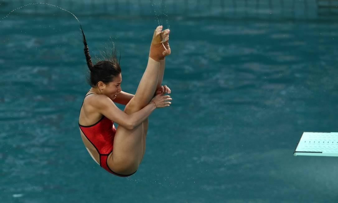 Zi He ficou atrás da compatriota Shi Tingmao, que levou o ouro, no salto ornamental no trampolim de 3m. A medalha de bronze foi para a italiana Tania Cagnotto STEFAN WERMUTH / REUTERS