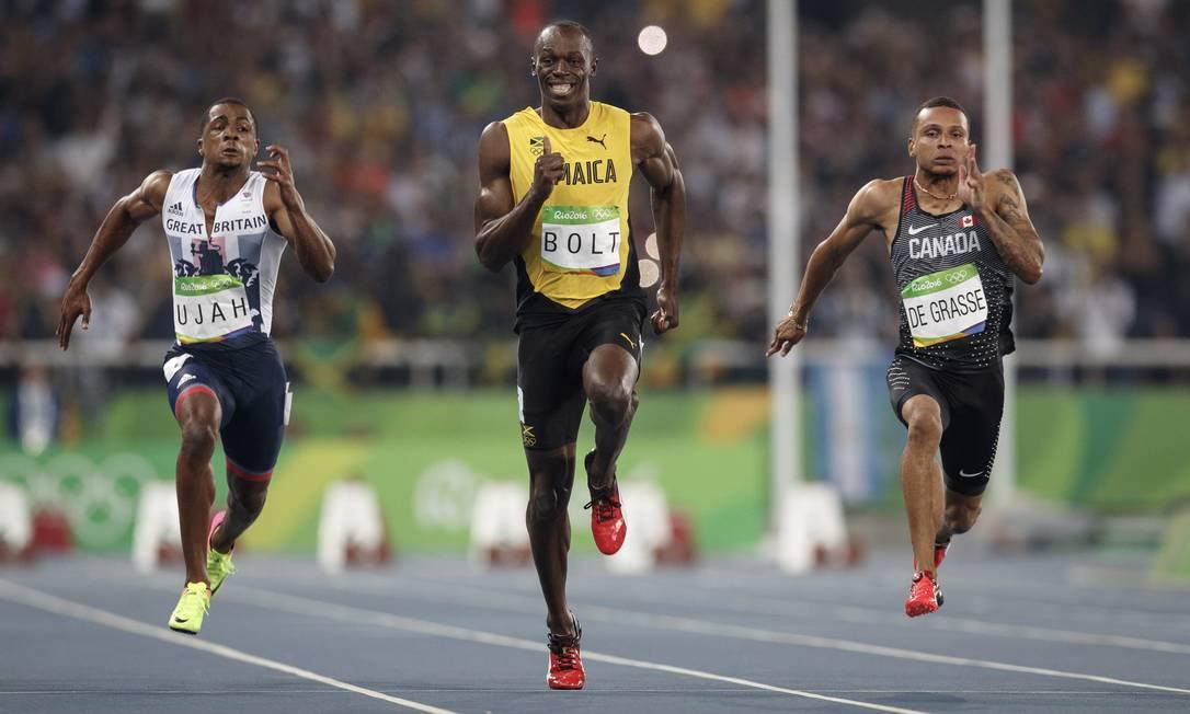 O jamaicano Usain Bolt corre na semifinal dos 100m rasos masculino no Estadio Olímpico do Rio, o Engenhão Daniel Marenco / Agencia O Globo / Agência O Globo