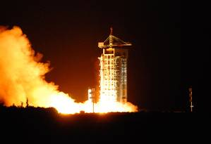 Lançamento do satélite na província de Gansu, na China Foto: STR / AFP