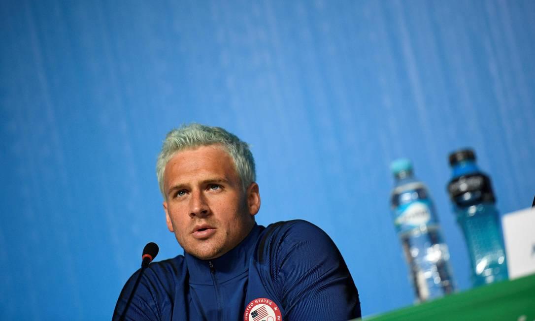 Ryan Lochte em entrevista no Rio em 3 de agosto Foto: Martin Bureau / AFP