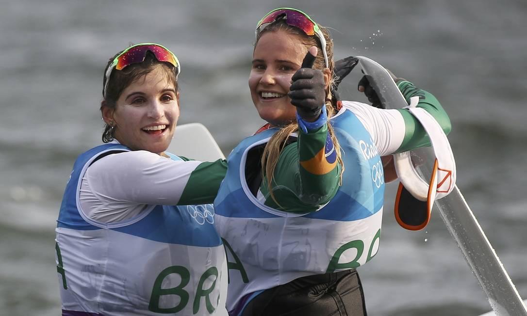 Cena linda de se ver: os sorrisos das campeão olímpicas Martine Grael e Kahena Kunze BENOIT TESSIER / REUTERS